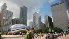 Downtown Chicago's Cloud Gate Sculpture Wide Pan Stock Footage