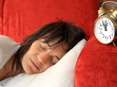 Angry woman overslept with alarm clock Stock Footage