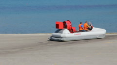 Small hovercraft move in the water bay Stock Footage