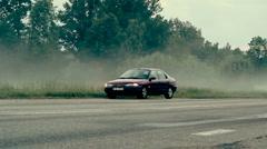 Broken car on misty road Stock Footage