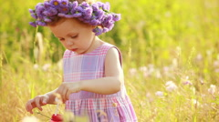 Child with boubles in the meadow Stock Footage