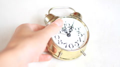 Hitting with a hammer on alarm clock Stock Footage