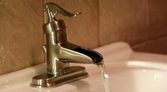 Old Fashioned Water Faucet With Running Water Stock Footage