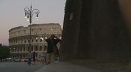 Family walk towards Colosseum slow motion Stock Footage