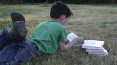 Boy reads  book Stock Footage