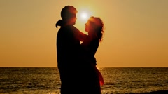 Boy and girl hug standing on beach, then leave to each other, part2 Stock Footage