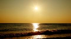 Sea, beach and evening sunset Stock Footage