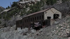 Abandoned mining building in the mountains - stock footage