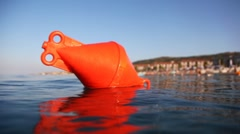 Buoy floats into sea Stock Footage