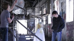 Haning up a Dummy in an abandoned warehouse - stock footage