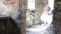 Kids walk into abandoned building with dummy - stock footage