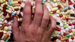 Stock Video Footage of hand grabbing many pills
