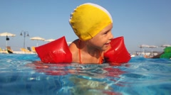 Girl climbs over partition pools on other side Stock Footage