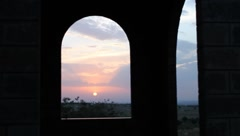 Beautiful African Sunset Through Church Arch (HD) Stock Footage