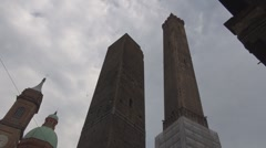 The two leaning tower in Piazza Ravegnana, Bologna, Italy, famous landmark icon Stock Footage