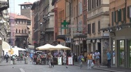 Beautiful street in Old Town of Bologna, commercial road shopping area Italy Stock Footage