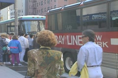 Tourists get on a Gray LIne Bus Stock Footage