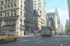 A Gray Line bus and a yellow taxi on the streets on Manhattan Stock Footage