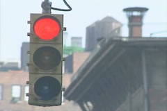 A red traffic signal turns to green Stock Footage