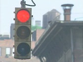 Stock Video Footage of A red traffic signal turns to green