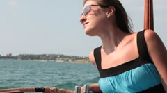 Woman looking overboard from the ship Stock Footage