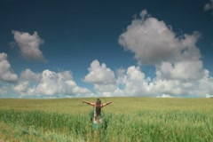 Stock Video Footage of Woman in Wheat Field With Arms Outstretched