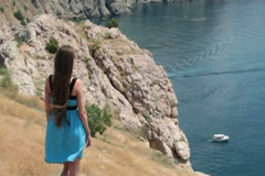 young woman looking at sailing motorboat - stock footage