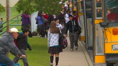 School students and school busses, #1 - stock footage