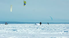 Snow-kiting on a frozen lake Stock Footage