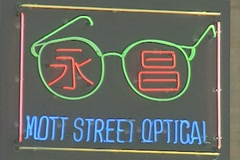 Neon sign advertising an optician in Chinatown, Manhattan Stock Footage