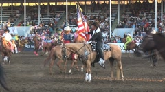 Cowgirls and flag - stock footage