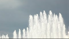 Tilt shot of the fountain stream against dramatic sky Stock Footage