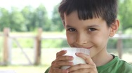 Boy drinks milk Stock Footage
