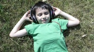 Stock Video Footage of boy listens to music