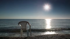 One chair stands in water washed by sea surf Stock Footage