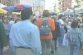 People walking through a street market in Little Italy Footage