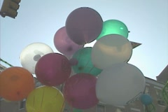 Balloons for sale during a street market in Little Italy - stock footage