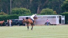 POLO PLAYER HITS BALL Stock Footage