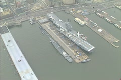 Aerial Shot of the USS Intrepid museum on the Hudson River Stock Footage
