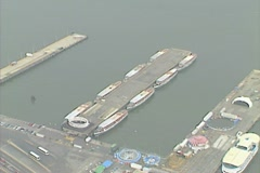 Aerial shot of Circle Line Sightseeing boats moored at their pier Stock Footage