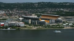 Riverboat sails past Pittsburgh Heinz field seen from Mt. Washington. Stock Footage