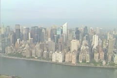 Aerial shot from the East River - Empire State Building, United Nations and more Stock Footage