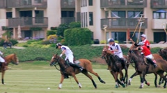 2 POLO RIDERS TAKE CORNER Stock Footage