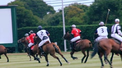POLO PLAYERS RACE BY SCOREBOARD Stock Footage