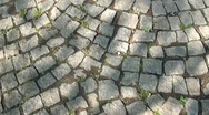 Walking along a stone pavement Stock Footage