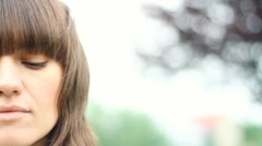 Portrait of sad young woman outdoor, close up Stock Footage