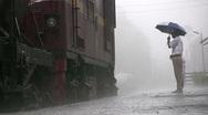 Downpour in Sri Lanka, monsoon, heavy rain, train, man with umbrella Stock Footage