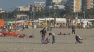 Stock Video Footage of Family relaxing and walking on the sandy beach,  Rimini, Italy,