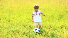 Boy preparing to get the ball into the goal Stock Footage