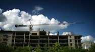 Construction crane working against the blue sky and clouds Stock Footage